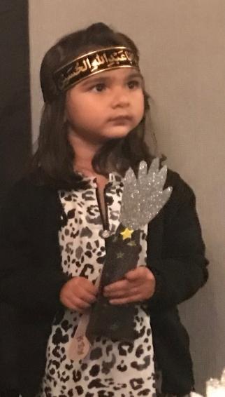 Ridha Zaynab holding her alam